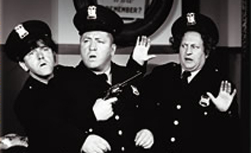 Still shot from the movie: The Three Stooges: Cops and Robbers.